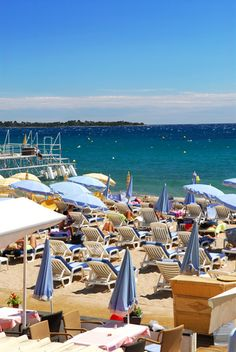 Cannes, France -- this was literally the beach/restaurant that we spent the day at!! Who could forget those blue umbrellas and that stunning view???