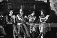 1979: From left to right, John Cleese, Neil Innes, Michael Palin and Eric Idle dressed as Arthurian knights on the set of 'Monty Python and the Holy Grail'.