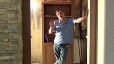Bob Schmidt shows you how to take a factory built cabinet and some simple hardware to make a bookcase door. when you are doing any project you kind of . Sliding Barn Door Hardware, Barn Doors, Bookcase Door, School Bus Conversion, Basement Plans, Secret Rooms, Built In Cabinets, Plumbing Fixtures, Building Plans