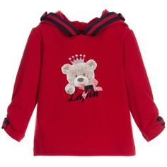 Girls dark red hooded top by Lapin House. Made in cotton, with added elastane for stretch, the top has an attached hood decorated with navy blue and red grosgrain ribbon and matching bow appliqué with diamanté at the centre. The front has a cute print of a Teddy Bear wearing a jewelled crown with bows and the designer's name displayed at the chest, with long sleeves, ruched cuffs and matching bow appliqué.