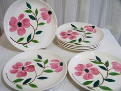 Vintage Hand Painted Floral Cake Plate Pottery Plate Set of 7 by SmakBoutique on Etsy https://www.etsy.com/listing/158835670/vintage-hand-painted-floral-cake-plate