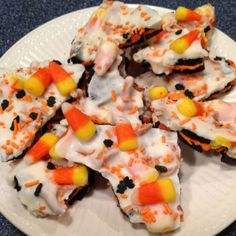 "Oreo Halloween Bark...FYI Almond Bark does NOT melt easily so add 1 tbs of Crisco at a time while melting for ability to ""drizzle"" or use melted choc chips for easier option! ~Amanda"