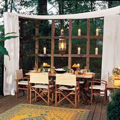 outdoor dining table in curtained alcove