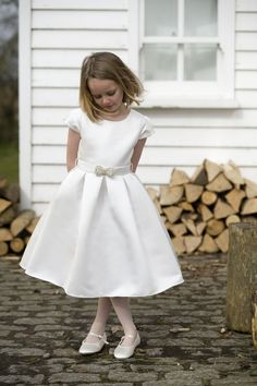 Ruthie is a satin 50s inspired dress with belt and pearl and beaded bow, #weddings, #flowergirls, #ivory, #1950s, http://www.nickimacfarlane.com/our-collections/the-cygnet-collection/ruthie/