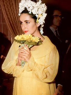 At her first wedding to Richard Burton, Elizabeth Taylor said 'I do' in a yellow chiffon dress. Image: Getty
