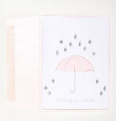 Shower them with love this spring with this rainy day inspired felt card. Gleaming with small teardrop gems and a pink umbrella, this card will make even the rainiest of days sunny. Features:  - Teardrop gems. - Blank white interior. - Card is made and backed on a wedding white