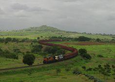 Pune WDG3a Shakti negotiates a 'S' curve towing a WDG4 and a fully loaded BCNA rake, taken at outskirts of Ranjangaon Road on Daund Manmad line.