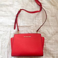 MICHAEL KORS red bag SO HOT! Really tough for me to sell so price is firm. Hardly worn. Michael Kors Bags
