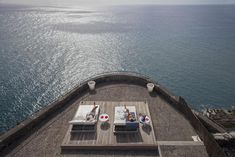 Perched on a cliffside overlooking the Atlantic Ocean on Madeira's south coast is Estalagem da Ponte do Sol. This design hotel is set in a renovated traditional farmhouse with modern wings added. It offers a stunning infinity pool and hot tub with panoramic views.