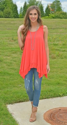 This coral top is made for some fun in the sun! Just pair a cute kimono and a floppy hat to complete its stylish look!