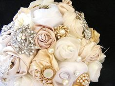 My friend did a fabric and brooch bouquet for her wedding. I prefer actual flowers, but the combination of these colors might go really well with a blush or champagne colored dress.