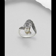 """SS snake ring decorated with Fresh water pearl 925 SS Snake Ring decorated with Fresh Water Pearl and Marcasite.  Top width  - 26.5 mm or 1"""". 6.9 Gr. Size7 Jewelry Rings"""