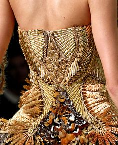 Alexander McQueen - the more I study this man's work, the more I appreciate the pure genius that went into it.  Rest in Peace, you left this world to soon.  AMS