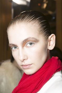 Damir Doma: For the Damir Doma Fall 2013 show, the models wore a matte pale blue shadow topped off with a metallic bronze shade.