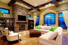 Love the windows, ceiling beams, fireplace