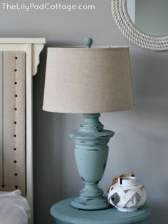 Chalk painted lamp DIY. Give a bright coastal vibe to a dark wood lamp with Annie Sloan Duck Egg Blue paint.