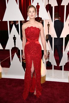 The scalloped neckline, Angelina-like high slit, and hourglass-creating seaming make Rosamund Pike's Givenchy look flawless and bold from every angle, down to the understated Lorraine Schwartz jewels.