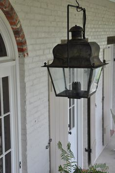 love the lantern against the white painted bricks