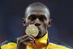 Jamaica's Usain Bolt kisses his gold medal during the men's 100m victory ceremony during the London 2012 Olympic Games at the Olympic Stadium August 6, 2012.