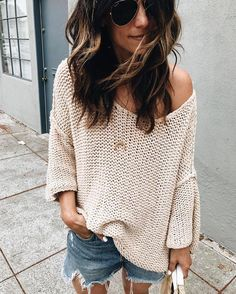 Loose, off the shoulder cream sweater and jean shorts