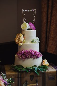 Three tier wedding cake decorated with flowers   Photography by http://www.libbychristensen.co.uk/