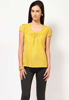 A yellow coloured top for women by Miaminx. Made of 100% cotton, this comfort-fit, printed top has hip length, short sleeves and a round neck.