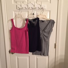 3 tops shown-- 2 for$10 or 3 for $13 Pink cami w lace edge in small, black racer back tank (says M but more of a small), silver shimmer top in small. Selling 2 for $10 or all 3 for $13. If u want two please comment & I'll set up a listing for you. Tops