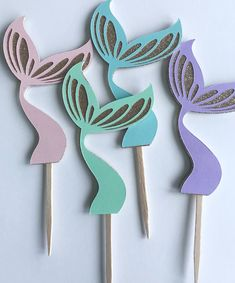 Set of 12 pastel mermaid tail cupcake picks. Perfect for mermaid and under the sea glam parties and events. Size: 4 inches Color: Aqua, light blue, light pink, lavender Toppers are double sided Package includes: 3 Aqua 3 Light Pink 3 Light Blue 3 Lavender Mermaid Birthday Party Decorations Diy, Little Mermaid Decorations, Mermaid Party Favors, 5th Birthday Party Ideas, Mermaid Theme Birthday, Little Mermaid Birthday, Little Mermaid Parties, Barbie Birthday, 3rd Birthday