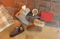 """Sipping on hot tea and nuzzling into your favorite cozy sheepskin slippers never felt so good.   ZDAR, Acorn and Bearpaw bring whole new meaning to the word """"cozy""""."""