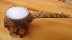 The candle light holder is made from pine tree wood. The wood exterior has a interesting design. The wood comes from old pine tree that fell in a storm. Finished with lacquer. . Dimensions:1) 6.5cm x diameter 15cm candles diameter 38mm