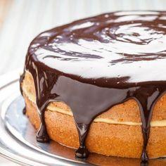 The Best Boston Cream Pie, ever. Tender, moist cake layered with creamy custard and topped with dark chocolate ganache. Unforgettable.