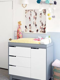 Sleek and grow-with-child Babyletto dresser in light grey for baby nursery from Target