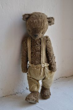 old teddy...was worn' bare'! the twins slept together with him until they were 4 or 5....