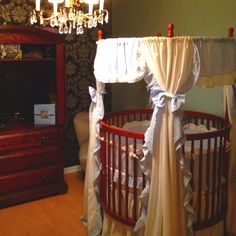 This is our son Ethan's bedroom! His crib is a round crib. The light baby blue paint is a Venetian plaster that has a slight silver shimmer. The other accent wall is a dark blue almost purple color with a silver damask painted over. Will post other pictures of his matching closet.