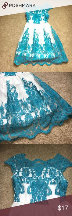 Lacey dress White and teal dress. Hits mid calf. Worn once. Looks great in pictures, would be good for a photo shoot. Lined, but outer layer of material is a bit scratchy when it does touch skin. In perfect shape! Size S. Dresses