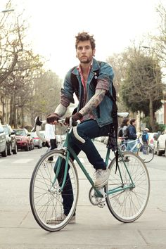 The hair. The tattoos. The clothes. The bike.....men's fashion at its finest
