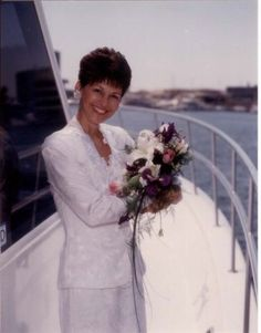 This beautiful lady is holding the bridal bouquet while posing on the bow of this stylish luxury yacht in Newport Beach, California. Boat Wedding, Yacht Wedding, Charter Boat, Wedding Flowers, Wedding Dresses, Luxury Yachts, Newport Beach, Floral Design, Bouquet