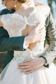 Romantic short sleeve lace wedding dress with intricate beading; Featured Photographer: Kayla Johnson Photography