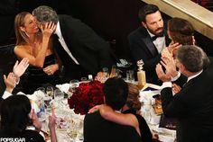 Stacy Keibler and George Clooney showed affection and Ben Affleck embraced Jennifer Garner at their table.