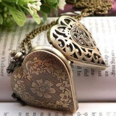 Vintage Heart Shaped Locket with clock inside.     I freaking want this sooooo badly!!!