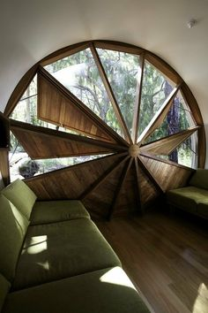 How to describe this awesomeness...Twelve sided round-ish window with windmill inspired fixed? shutters or blinds.  It's cool, whatever you call it.