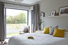 The bedroom is a mix of subdued greys and playful colour pops. The shelf bed is from Ikea and the light is by Trentanove. The walls are painted in Paris Grey by Zoffany. Wall Galleries, Color Pop, Colour, Paris Grey, Black Accents, White Bedroom, Color Combos, House Tours, Grey And White