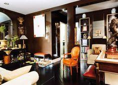 gilded-accents-dark-chocolate-painted-walls-laquer-black-painted-floor-cream-sofa-orange-chair-decorating-ideas-home-decor
