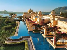 Take a private boat to the Oberoi Udaivilas, called the Best Hotel In India by TripAdvisor.