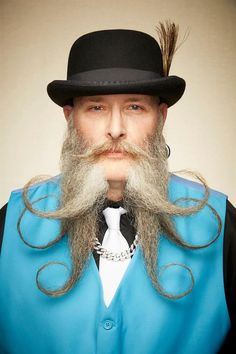 Competitors with facial hair fashioned into lavish shapes or decorated with feathers have entered the 2019 National Beard and Moustache competition in Chicago, including facial hair to rival Gandalf's. Crazy Beard, Full Beard, Epic Beard, Beards And Mustaches, Beard No Mustache, Moustache, Star Fashion, Fashion Beauty, Beauty Style