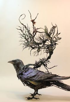 This listing is for an original, one of a kind, signed and dated sculpture. The corvid was built by hand and there is no other like it. It is