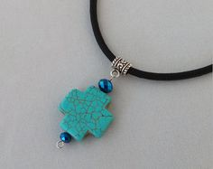 This necklace is handmade out of a black 550 paracord. It has a turquoise stone with a sea turtle print on both sides along with two black glass beads.  It has a silver lobster claw clasp for fastening.  This one measures 16 3/4 but can be made to any length you would like.