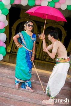 Bride in Turquoise and Blue Madisar Nine Yard Saree with Groom in Traditional Veshti