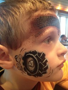 Love this tire face painting. Wish I knew how they did the tire print across top. Maybe a premade roller or stamp or maybe a homemade roller using a toy truck tire Face Painting For Boys, Face Painting Designs, Paint Designs, Mime Face Paint, Cheek Art, Monster Jam, Monster High, Boy Face, Maquillage Halloween
