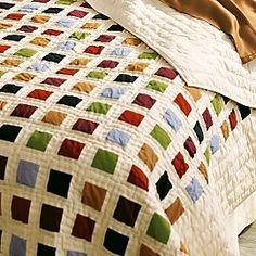 small squares.This quilt is so easy on the eye. I am going to make it with Kaffe Fassett Ikat plain fabrics, because there are so many colors!!!
